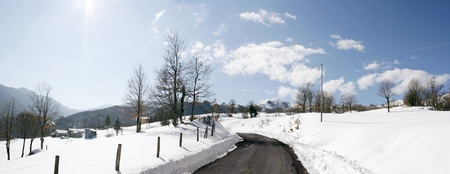 cornering: Wonderful scenic view of a mountain range houses from the road uphill curve