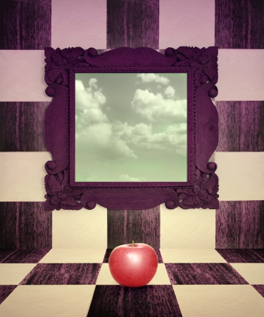 Surreal image representing a red apple in the center of the space with a mirror that reflected a cloudy sky Stock Photo - 18307071