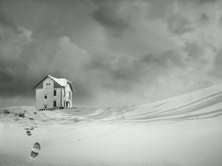 An isolated house in a wonderful snowy landscape and dramatic sky in black and white photo
