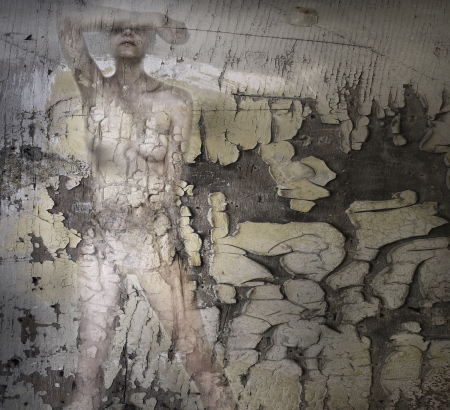 Female naked body camouflaged with the background in wood