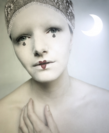 pierrot: Beautiful portrait of a girl make up as Pierrot Lunaire Stock Photo