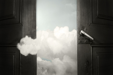 enters: Artistic surreal background representing an opened door with the sky and a cloud that enters  Stock Photo
