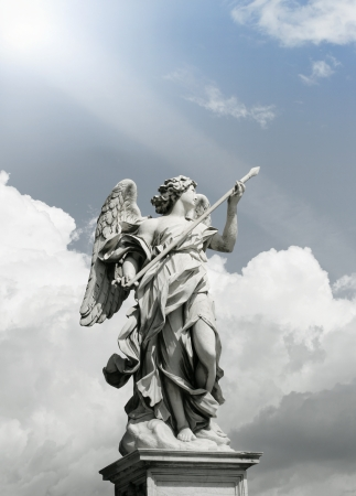 Beautiful Angel sculpture in Rome with an incredible dramatic cloudy sky on the background photo