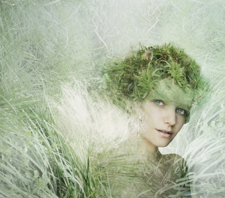 Young woman model with an artistic imaginative dress with part of nature Standard-Bild
