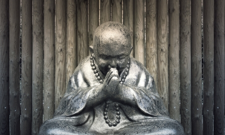 Beautiful Buddha statue in a meditative posture of prayer Stock Photo - 21572935