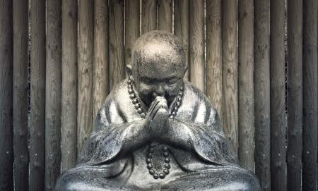 Beautiful Buddha statue in a meditative posture of prayer Stock Photo - 21572935