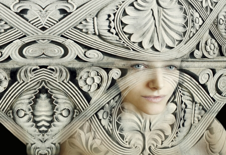 Artistic portrait of a female camouflaged in a sculpture composition Stock Photo - 21857547
