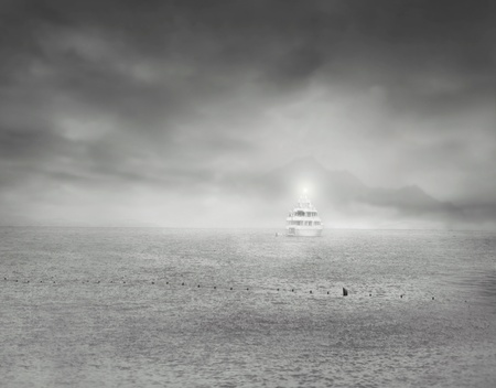 An isolated boat at sea with a dramatic sky in black and white Stock Photo - 21892553