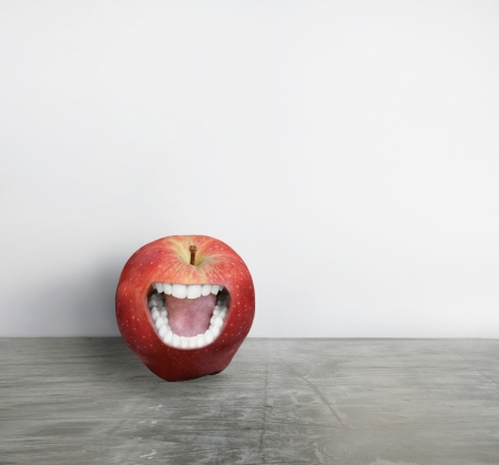 Artistic creation of a red apple with a human mouth that screaming