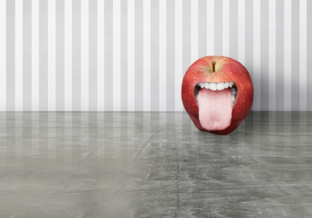 Artistic creation of a red apple with an opened human mouth that sticking out his tongue