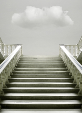 Artistic surreal imagine with a stairway with a cloud inside the room photo