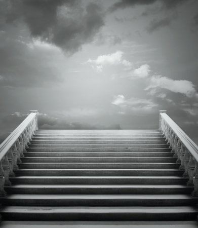 Beautiful staircase with a cloudy sky in black and white Stock Photo
