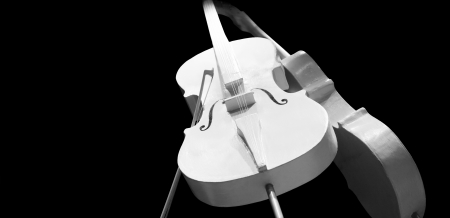 cellos: Two elegant white cellos  instrument isolated on black background Stock Photo