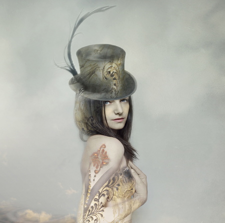 Beautiful artistic portrait of an extravagant lady in an eighteen century style and cylinder with clouds in the background