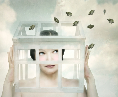 Surreal girl with a small wooden and and glass little house in her head that looks the butterflies outside