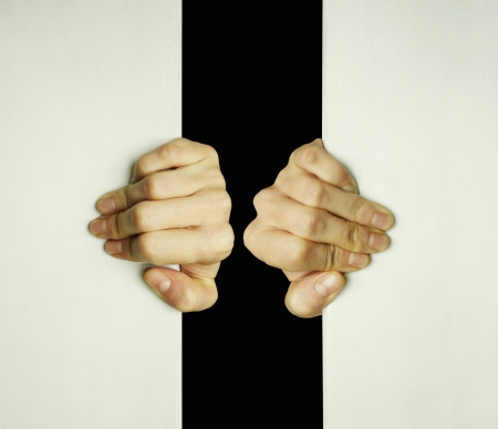 psyche: Concept of two hands trying to open a slit to exit from the darkness