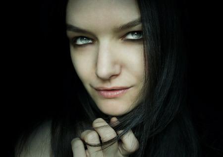 Beautiful female model portrait in the darkness