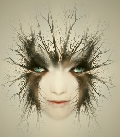 open minded: Artistic surreal portrait of a beautiful face of a young woman transformed in mysterious creature