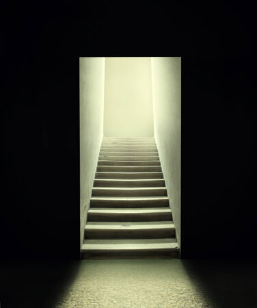 Staircase inside a room in the dark photo