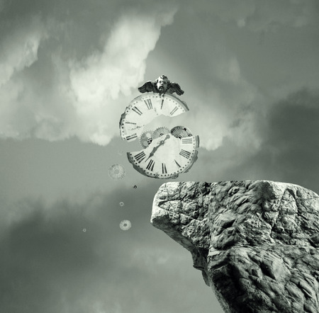 surreal: Metaphysics imagine representing an old and broken clock that falls off a cliff in a dramatic and surreal background Stock Photo