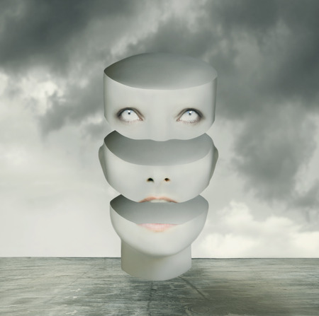 break up: Metaphysics imagine representing an human head divided in three parts in a surreal background Stock Photo