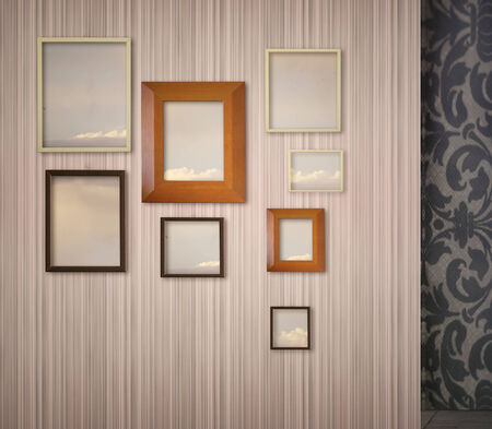 hung: Pink stripped wallpaper with hung a variety of picture frames with sky and clouds inside