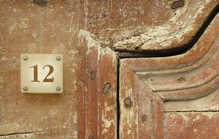 Detail of an old door and the number twelve Stock Photo