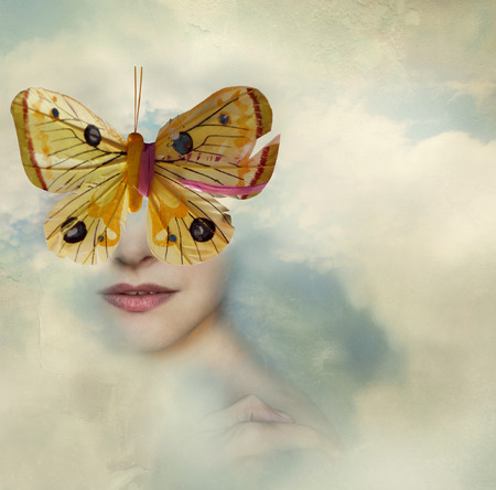 Surreal image representing a female portrait shrouded in the clouds with a butterfly instead of her eyes Stock Photo