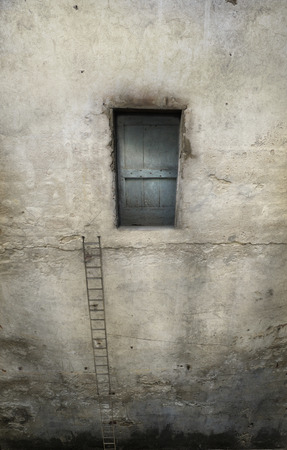 overhanging: Surreal overhanging wall with door and a long staircase Stock Photo