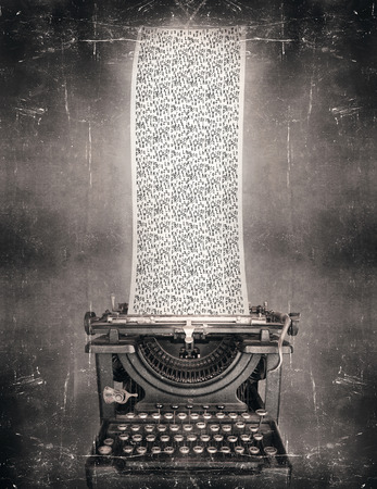 Surreal imagine in black and white of a beautiful classic old fashioned typewriter with a very long paper full of the alphabet letters in a vintage style photo