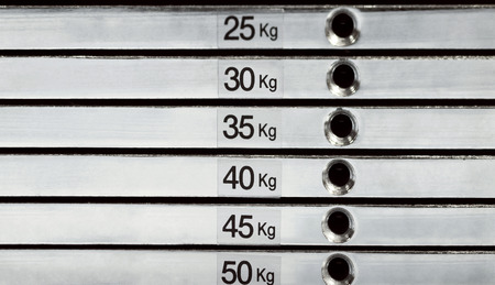 equivalent: Abstract detail of weight stack with equivalent in kilograms Stock Photo
