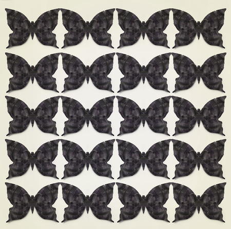 repeated: Beautiful abstract graphic stylized black butterflies repeated