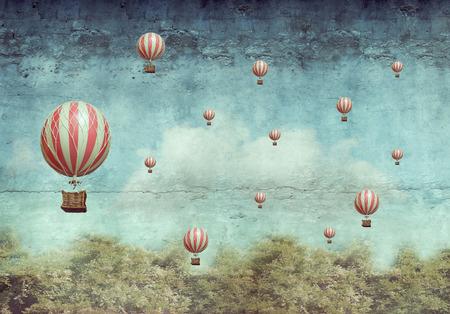 globo: Muchos globos de aire caliente volando sobre un bosque Foto de archivo