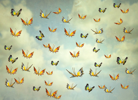 surrealist: Many colorful butterflies flying into the sky, illustrative photo and artistic
