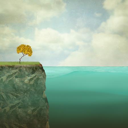 해외 바위 꼭대기에 자리 잡은 작은 나무의 초현실적 인 그림