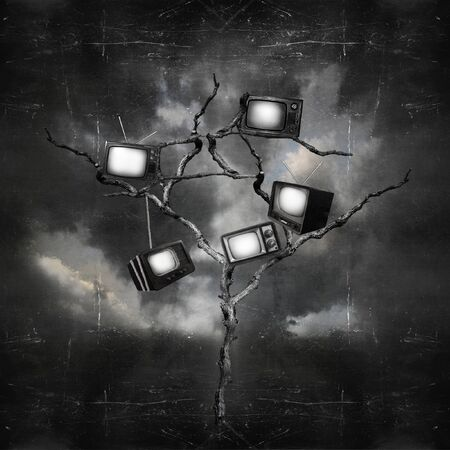 metaphysical: Black and white image of a dark and surreal landscape with a tree that has hung old TVs Stock Photo