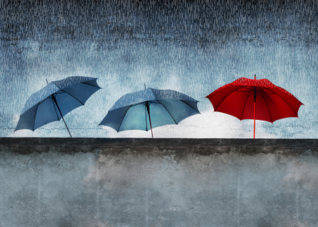 poetic: Artistic image of three umbrellas, one red behind a wall in the rain Stock Photo
