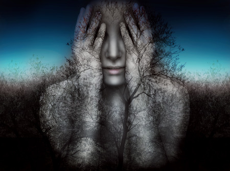 surrealism: Surreal and artistic image of a girl who covers her eyes with her hands on a background of trees and sky