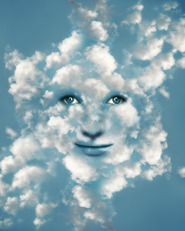 Surreal imagine representing a fantasy beautiful face camouflaged in blue light sky with many clouds  photo