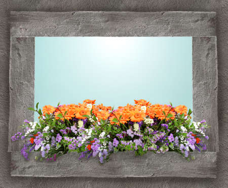 Colorful floral composition on a window sill with a window open on the sky