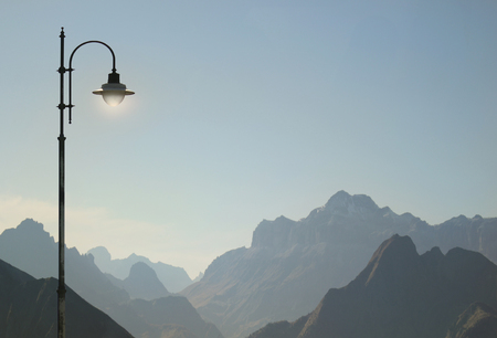 Beautiful and poetic view of Dolomites Alps in Italy with a street lamp detail 免版税图像