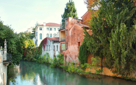 Beautiful characteristic view from the bridge with houses and river in Padua, Italy