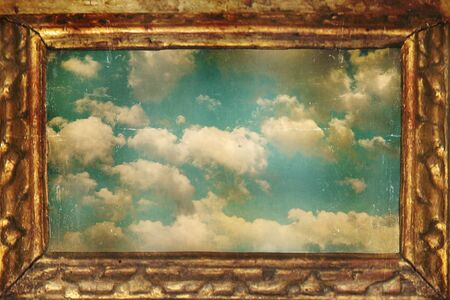 Beautiful background that represent a golden frame with sky and clouds in a vintage style