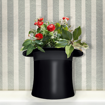 A beautiful imagine representing a black cylinder use like a vase with red roses inside Stock Photo