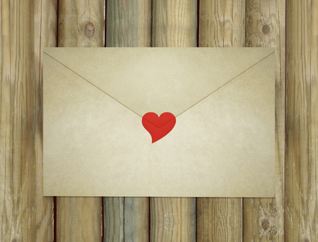 A love letter envelope enclosed by a red heart 免版税图像