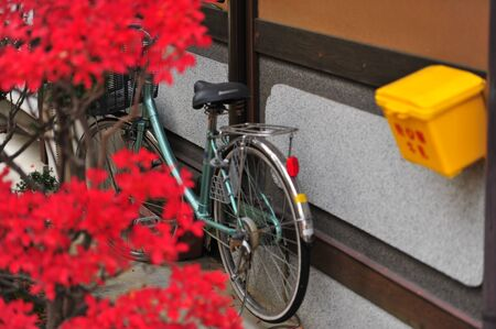off road biking: Postbox  and bicycle in Japan Editorial