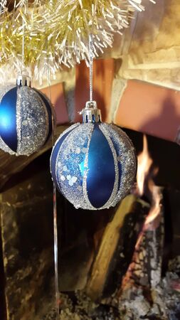 hearthside: Christmas decoration fireplace with blue glass balls and gold garland