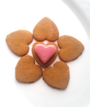 pretty s shiny: Sweet pink red marzipan heart and hearts biscuits on white background Stock Photo