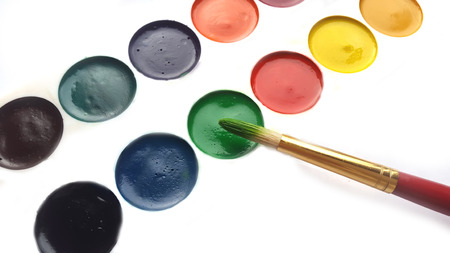 painter's palette: Painters palette and brush on white background