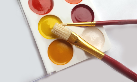 paintbox: Watercolors with brush on white background. Stock Photo